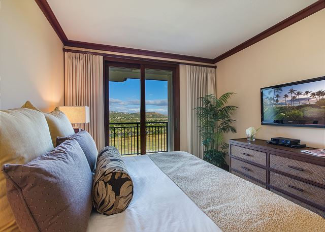 Master Bedroom with king bed, flat screen TV and mountain views