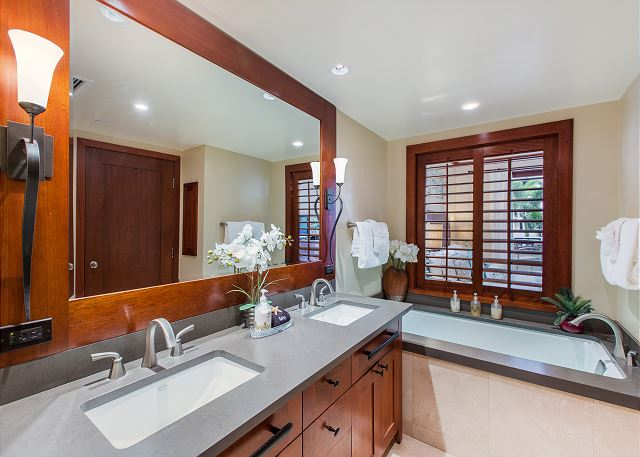 Master bathroom with separate soaking tub, double sinks and show