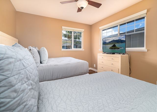 Guest Bedroom with Two Twin Beds and A Big Flat Screen TV