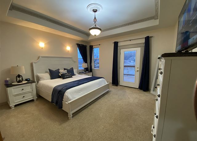 Master Bedroom: king bed, walk-in closet, smart TV, attached mas