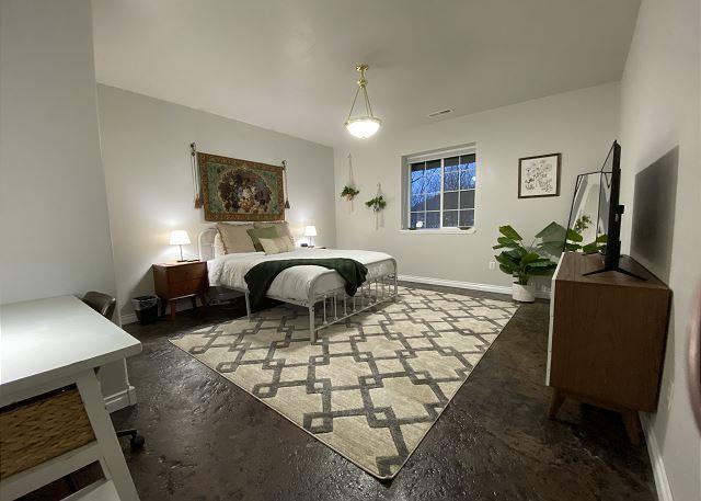 Bedroom 5: king bed, closet, desk, smart TV