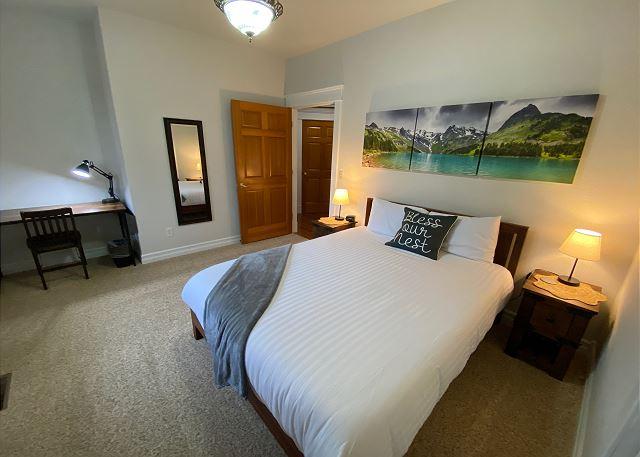 Bedroom 2: queen bed, closet, desk, smart TV