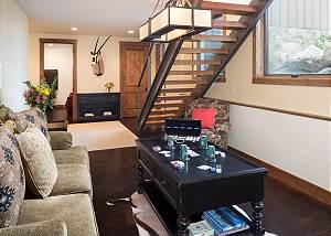 Den - Sofa and Staircase