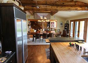 Spacious Kitchen and Dining Area with Exterior Door Leading to t