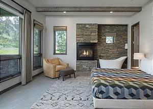 Guest Bedroom - Stone Fireplace and Queen Bed