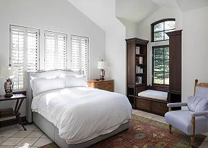 Guest Bedroom - Bed and Bookshelves
