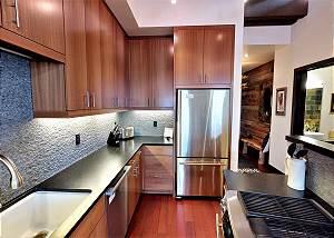 Kitchen - Sleek Countertops and Fridge