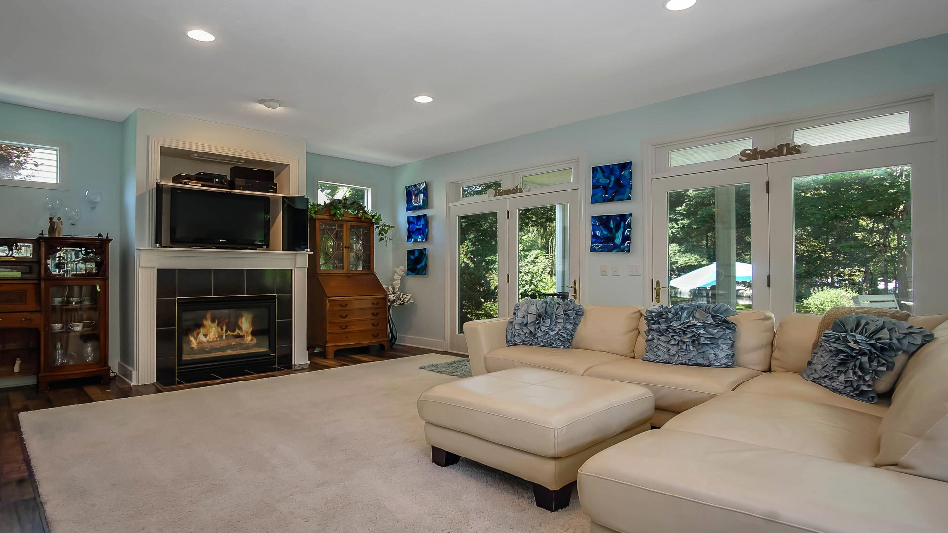The Living Area Boasts A Large Sofa, Gas Fireplace, And TV. Part 40