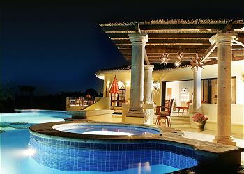 The pool at night is a wonderful area for entertaining