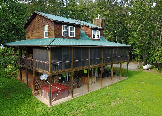 Elevation side showing screened porch and hot tub. The Tranquility Cabin also features Game Room with Pool Table, Internet access and much more.