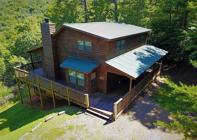 Vacation rental cabin with 3 bedrooms and 2 baths. Nice mountain views with hot tub, Internet, and game room with ping pong table and air hockey table.