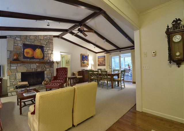 From the foyer looking in to the main living area with beautiful stone fireplace