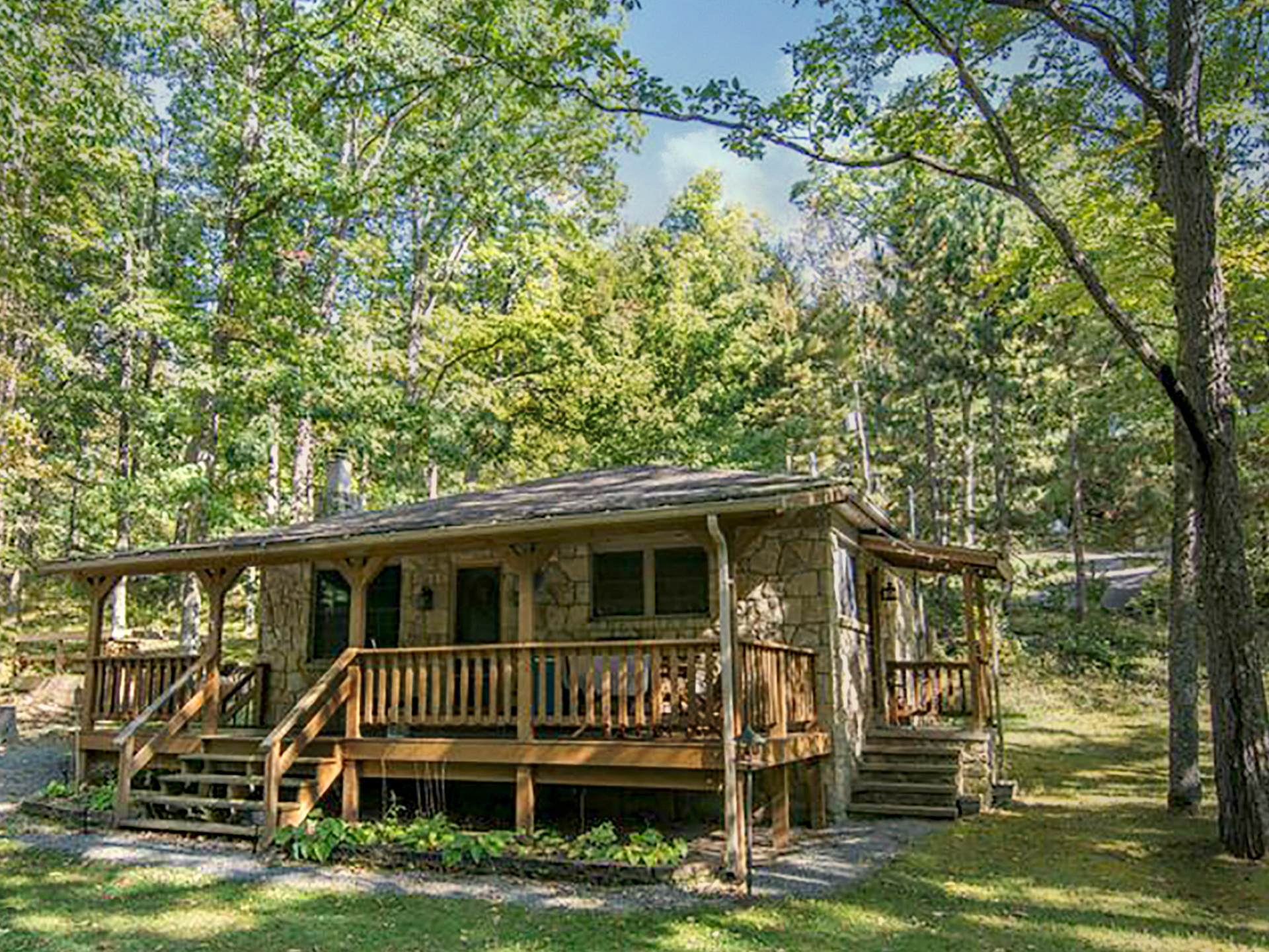 rental a boat honeymoon lodging maryland at trees among cabin of creek company rentals deep cabins pine in view md grove pontoon lake front