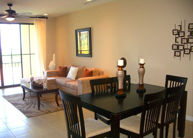 Welcome to Pacifico C407 The living area has a comfortable L-shaped sofa and is nicely decorated.