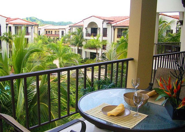 Enjoy dining on the balcony overlooking the pool and beautilful grounds of Pacifico.