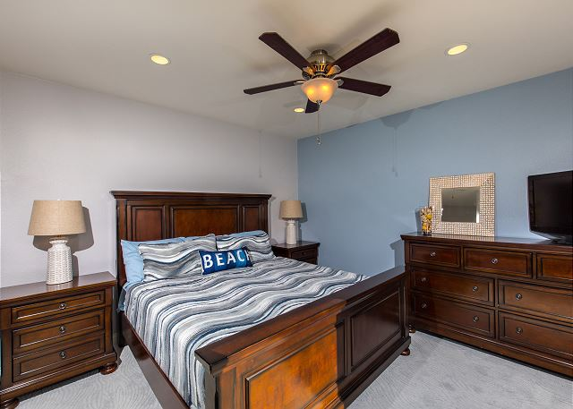 The Bedroom Is Decorated In Soothing Ocean Colors.