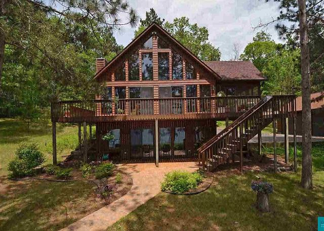 Sleeps 10 and  has a sandy beach, the perfect north woods family getaway