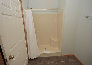 Shower stall with seat-Descriptive