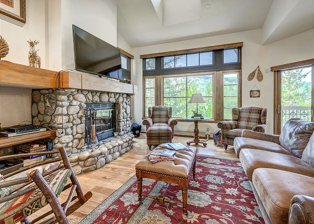 Spacious Living Room with Lots of Natural Light, Wood Burning Fireplace, and Flat Screen Television.