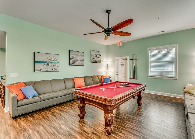 spacious family game room with continues sofas