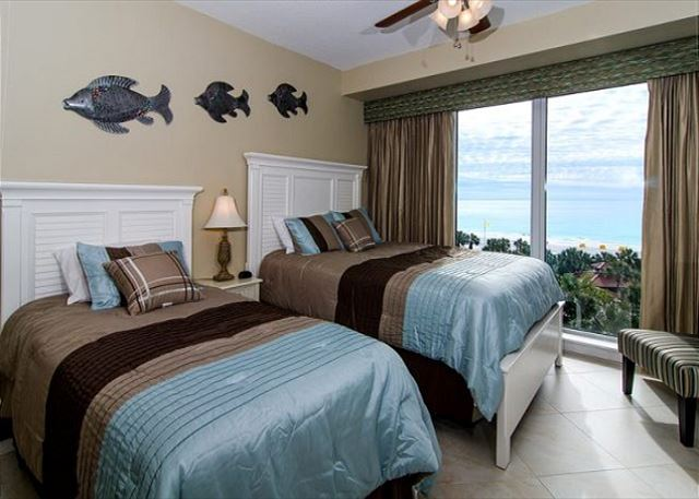 Guest Bedroom with Double Beds and Coastal Decor