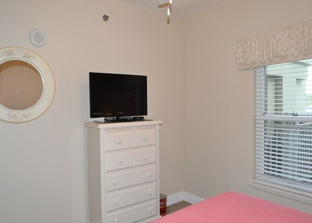 Flat screen TV in guest bedroom