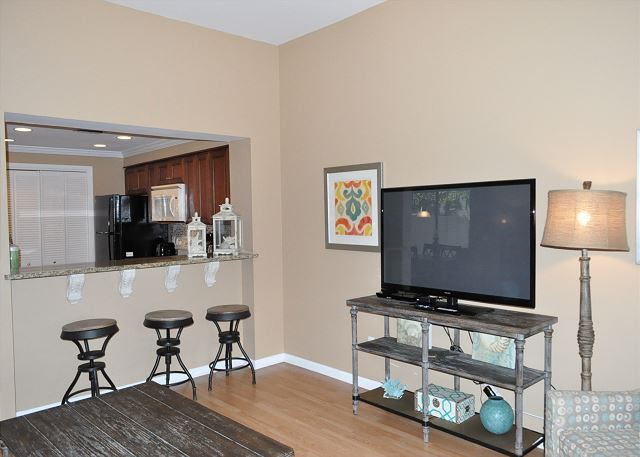 Breakfast bar with barstools and open to living area