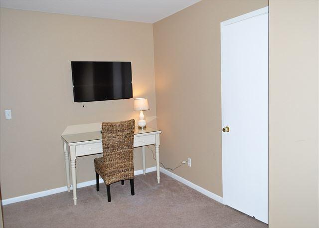 Loft TV and desk area