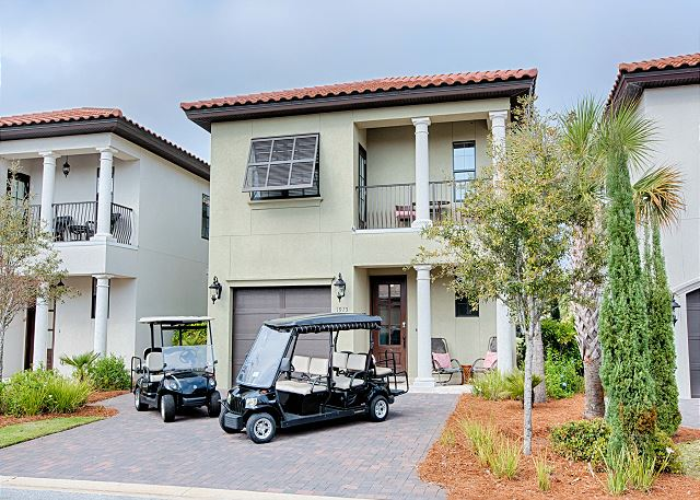 Font of home with golf carts