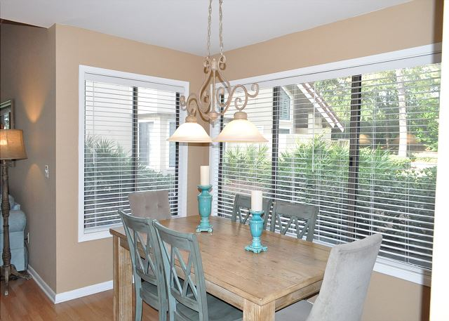 Dining area with lots of light from end unit windows