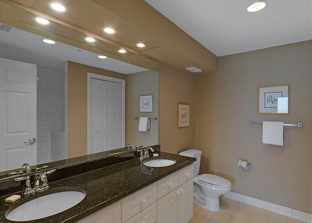 Master bath with dual sinks and upgraded granite counters will m