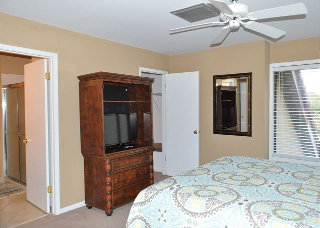Master bedroom with flat panel TV, en suite bathroom and large w