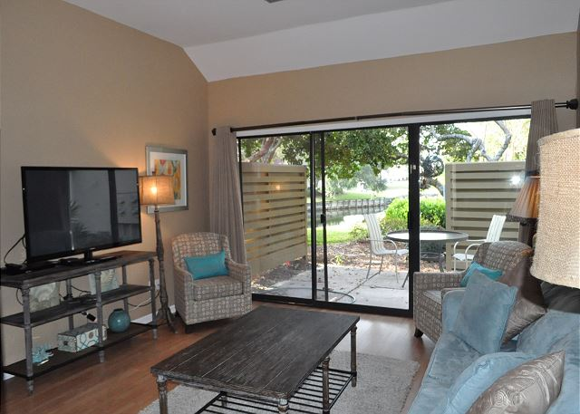 Living area with patio access and flat panel TV