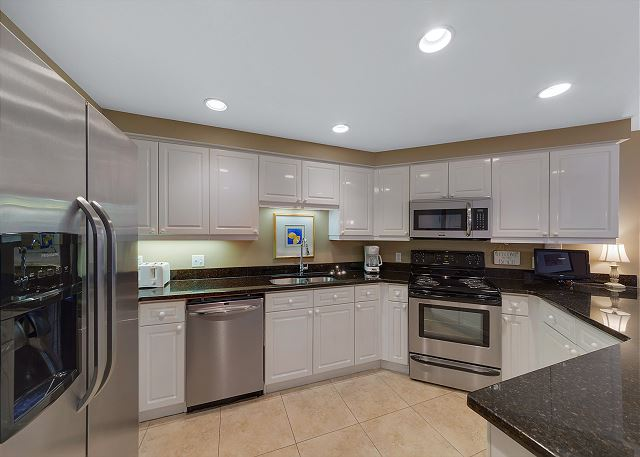 Updated kitchen with granite and stainless appliances