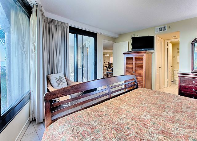 Bedroom With Large Bed and Entertainment Center