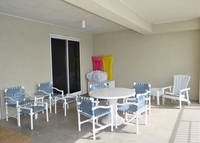 Lots of seating options and beach toys on the patio