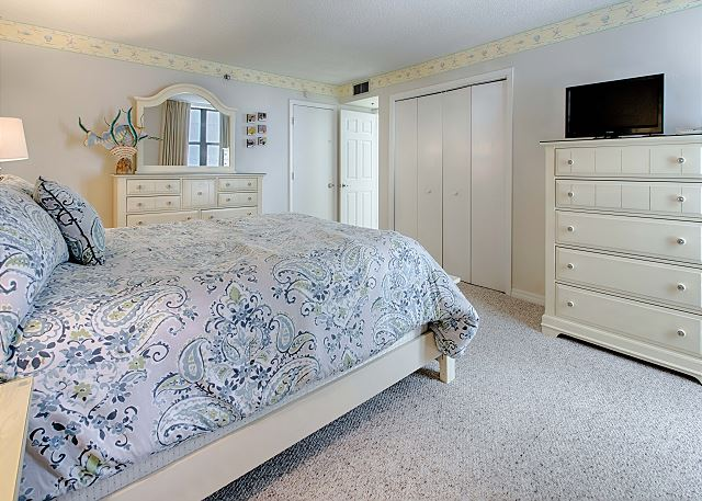 Bedroom With Large Bed and Entertainment