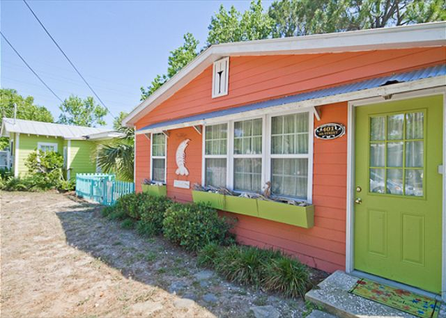 Front exterior of The Shrimp Cottage.  This cottage is located next door to Key Lime Parrot; renting both would be perfect for large families or groups!