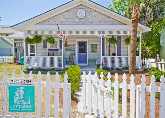 Front exterior of Inlet Breeze cottage. Notice the fantastic white picket fence, all of the wonderful details and the fun, colorful shutters and door!