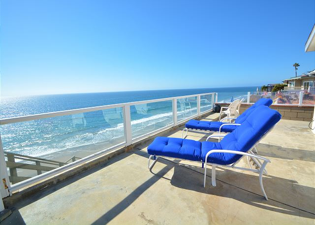Deck with the gorgeous ocean view and private stairs to the beach