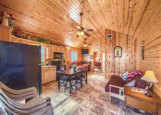 This cozy cabin has an open living/dining/kitchen space.