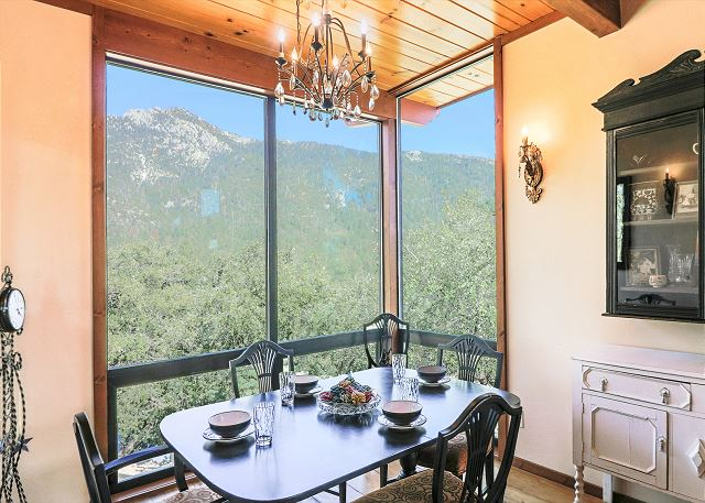 Elegant dining room with stunning mountain views.