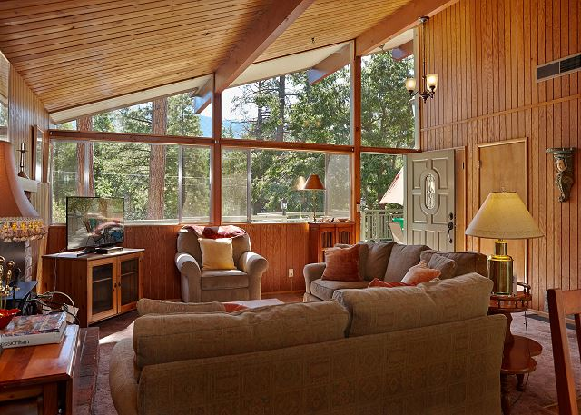 Living Room with vaulted ceilings brings the outside scenery inside the home.