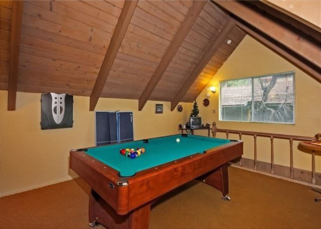 Loft includes a pool table.