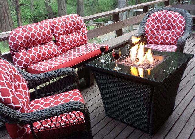 Kick back with a glass of wine and enjoy hanging out in the pines.