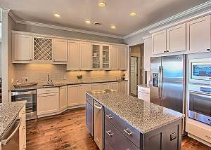Gourmet Kitchen with Ice Maker, Center Island, Beverage Center, and Prep Sink.