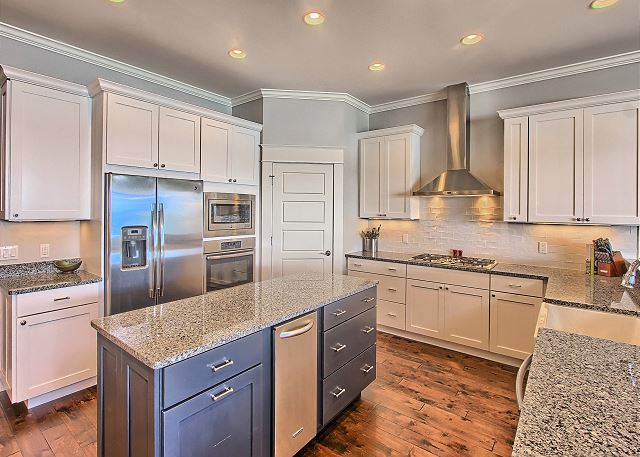 Gourmet Kitchen with Stainless Steel Appliances, Hardwood Floors, and Granite Counters.