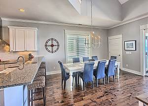 Dining Table with Seating for Eight - Additional Seating at Nearby Breakfast Bar.