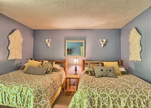Second Bedroom with Two Queen Beds and Flat Screen Television.
