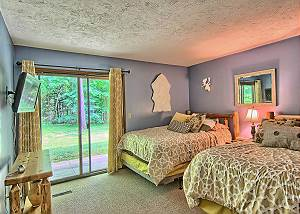 Another View of the Second Bedroom with Two Queen Beds and Flat Screen Television.
